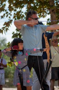 Wyla and her dad practice archery together. Photo courtesy of Pasadena Roving Archers.