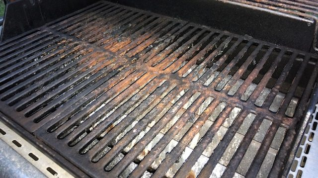 nasty looking grill covered in baked on leftovers