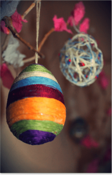 Fourth Doctor scarf and Spider-Man web string art eggs.