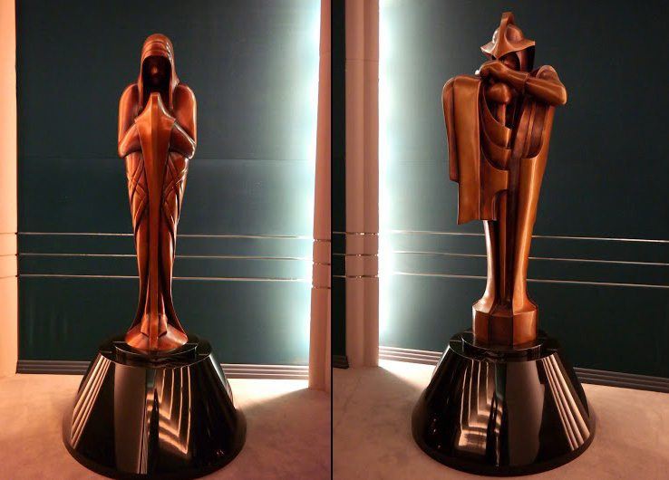 Statues on either side of the Stag Theater stage, Sistros (L) and Braata (R), two of the Four Sages of Dwartii, seen in Palpatine's office in Episode III. Photos courtesy of Sassy Mama in LA.