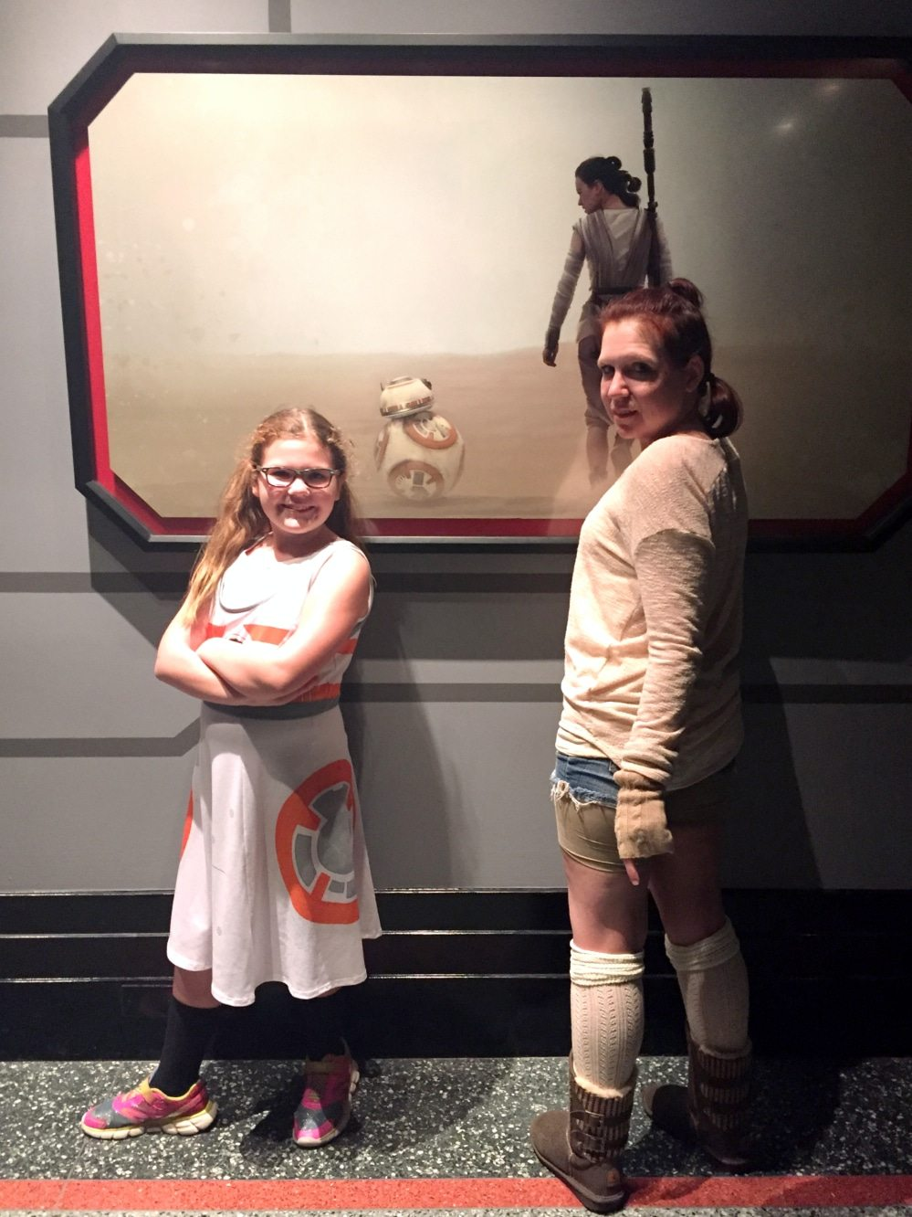 photo of Aeris and Anika with a poster of BB-8 and Rey